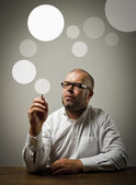 Creator. Man in white and gray bubbles. — Stock Photo