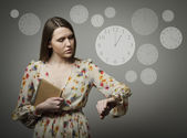 Young woman and wristwatch. 1 p.m. — Stock Photo