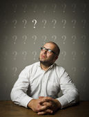 Man and question marks. — Stock Photo