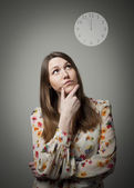 Thinking. Young woman and clock.  — Stock Photo