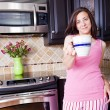Woman in kitchen - Stock Photo