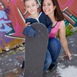 Kid with Skateboard - Stock Photo