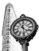 Clock and Flat Iron Building — Stock Photo