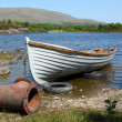 Old boat in a lake — Stock Photo