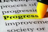 Word progress highlighted with a yellow marker — Stock Photo