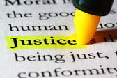 Word justice highlighted with a yellow marker — Stock Photo