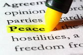 Word peace highlighted with a yellow marker — Stock Photo
