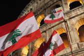Flags of Lebanon in front of Colosseum during Way of the Cross — Stock Photo