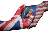 Handshake between United Kingdom and Malaysia — Stock Photo