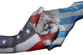 Handshake between United States and Uruguay — Stock Photo