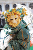 Female mask with umbrella at Carnival of Venice — Stock Photo