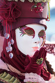 Red mask sending a kiss at Carnival of Venice — Stock Photo