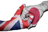 Handshake between United Kingdom and Japan — Stock Photo