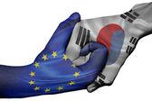 Handshake between European Union and South Korea — Stock Photo