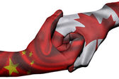 Handshake between China and Canada — Stock Photo