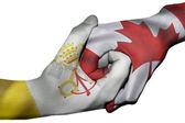 Handshake between Vatican City and Canada — Stock Photo
