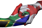 Handshake between South Africa and Canada — Stock Photo