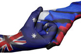 Handshake between Australia and Russia — Stock Photo