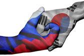 Handshake between Russia and South Korea — Stock Photo