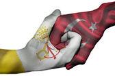 Handshake between Vatican City and Turkey — Stock Photo