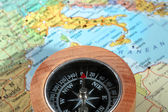 Travel destination Italy, compass with a map on the background — Stock Photo