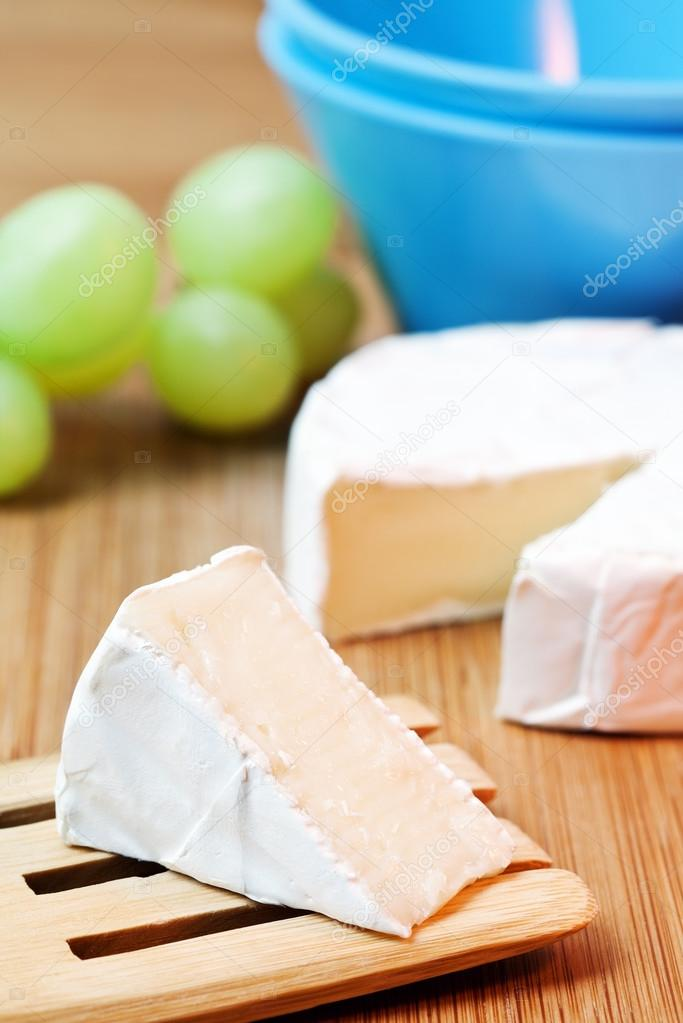 Delicious cheese brie on a table  — Stock Photo #13171134