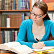 Girl studying in library — Stock Photo