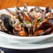 Bowl with cooked mussels — Stock Photo #13360131