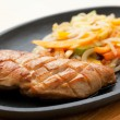 Постер, плакат: Grilled chicken breasts and noodles