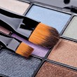 Brush and eye shadow - Stock Photo