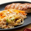 Grilled chicken breasts and noodles — Stock Photo
