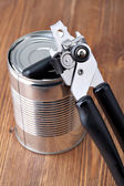 Opening tin can — Stock Photo