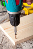 Screwing a screw — Stock Photo