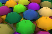 Many multicoloured umbrellas — Stock Photo