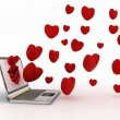 Hearts take off from screen of laptop — Stock Photo #12669953