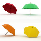 Multicoloured umbrellas on a white background — Stock Photo