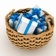 Gift boxes in a braiding basket on a white background - Lizenzfreies Foto