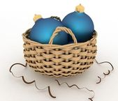 Glass Christmas balls in a wicker basket — Stock Photo
