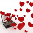 Hearts take off from screen of laptop — Stock Photo #16870453