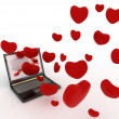 Hearts take off from the screen of laptop — Stock Photo