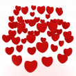 Foto Stock: Red hearts on white background