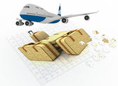 Plane flying over a puzzle consisting of suitcases — Stock Photo