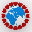 Earth with hearts — Stock Photo