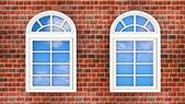 Windows on the brick wall — Stock Photo