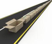 道路上的纸板箱的流. — 图库照片