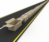 Stream of cardboard boxes on road. — Stockfoto