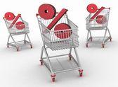 Três carrinhos de compras com sinal de porcentagem — Foto Stock