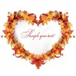 Autumn leaves in the heart frame with a red ribbon — Stock Vector