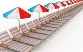Row from many deck-chairs with parasols — Stock Photo