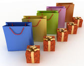 Boxes with gifts and paper bags — Stock Photo